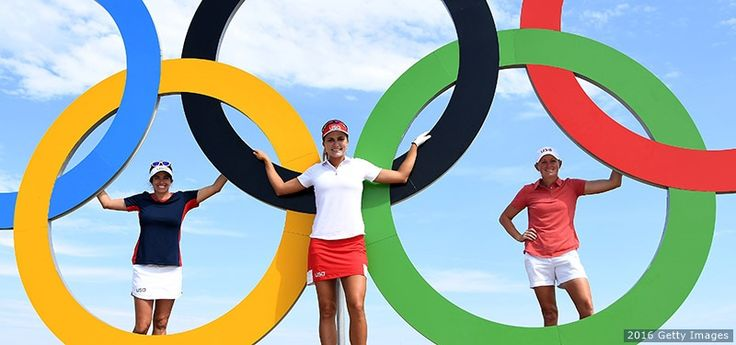 Gerina Piller, Lexi Thompson and Stacy Lewis pose with the Olympic rings at a practice round prior to the women's individual stroke play golf at the Olympic Golf Course at Olympic Golf Course on Aug. 16, 2016 in Rio.