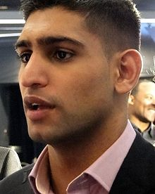 Amir Khan - British professional boxer. He is a former 2-time world champion by winning WBA, WBA (Super) & IBF Light Welterweight titles.  the youngest British Olympic boxing medalist, winning silver at the 2004 Athens Olympics at the age of 17. He is also one of the youngest British world champions ever, winning the WBA Light Welterweight title at age 22. Khan was born and raised in Bolton, England, in a Janjua Rajput origin British Pakistani family with roots in the Punjab.