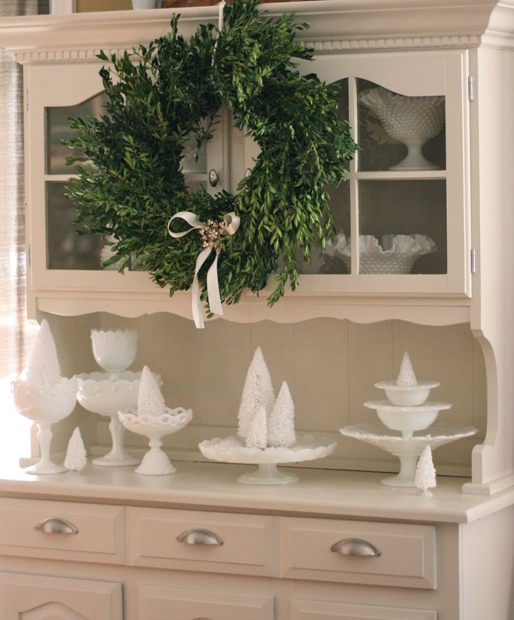 """Eve, my Goodwill hutch is dressed in Milk Glass and bottlebrush trees for her """"winter"""" look. Simple and pretty. Eve, my #Goodwill hutch, dressed in #milkglass and bottlebrush trees for her """"winter…"""