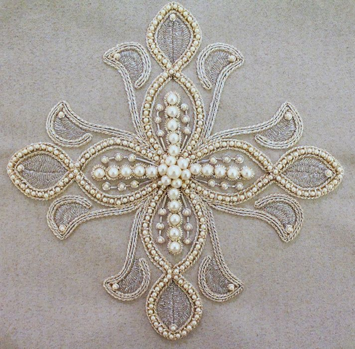 Embroidered cross made by a young woman named Tetiana.  Beautiful design with pearls and metallic threads.   Check out the site for other lovely pieces.