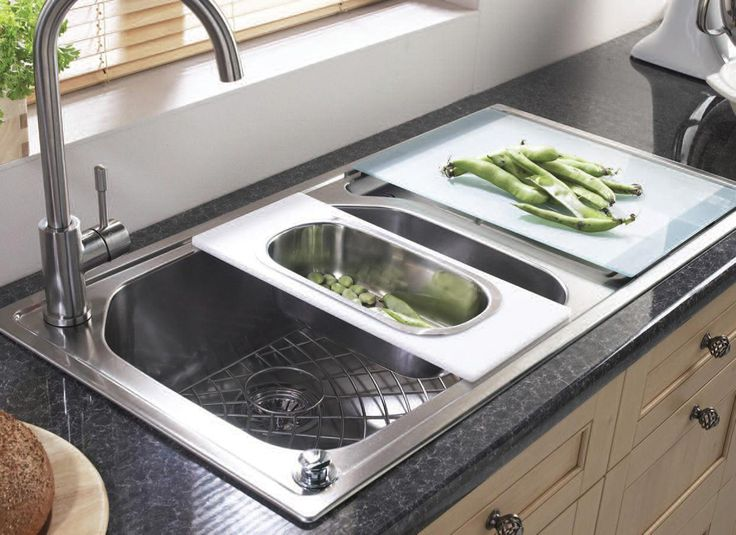 kitchen sink accessories with vegetables that have been washed