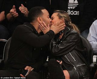 JOHN LEGEND AND WIFE SHARE PASSIONATE KISS AT BASKETBALL GAME   John Legend and his wife of 3 years Chrissy Teign were seen kissing at the Staples Center in Los Angeles ..  See more photos below..