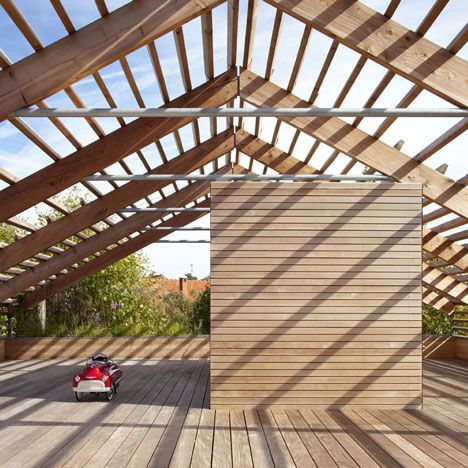 Eco-Sustainable House by Djuric Tardio Architectes Roof is actually a pergola for growing fruit over a roof terrace. Also a great play area.