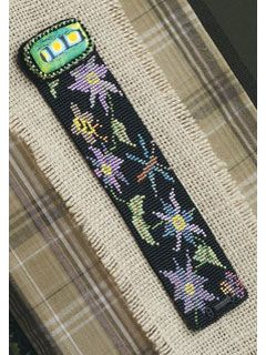 Flower Garden Loom-Woven Bracelet by Lynn Smythe. Make this loom-woven cuff bracelet with a beautiful flower pattern! Beaded bracelet pattern available as an instant download from the Beading Daily Shop.