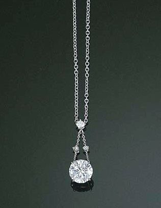 A DIAMOND PENDANT NECKLACE The circular-cut diamond weighing 2.08 carats suspended from the diamond collet twin line surmount, to an oval-link neckchain, mounted in 18k white gold, 41.7 cm