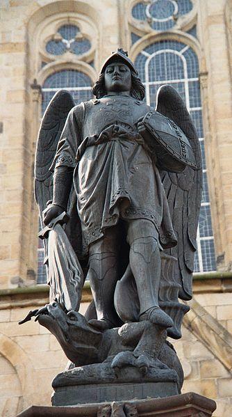 Memorial statue of Archangel St. Michael at the market square of Mettingen, Kreis Steinfurt, North Rhine-Westphalia, Germany.