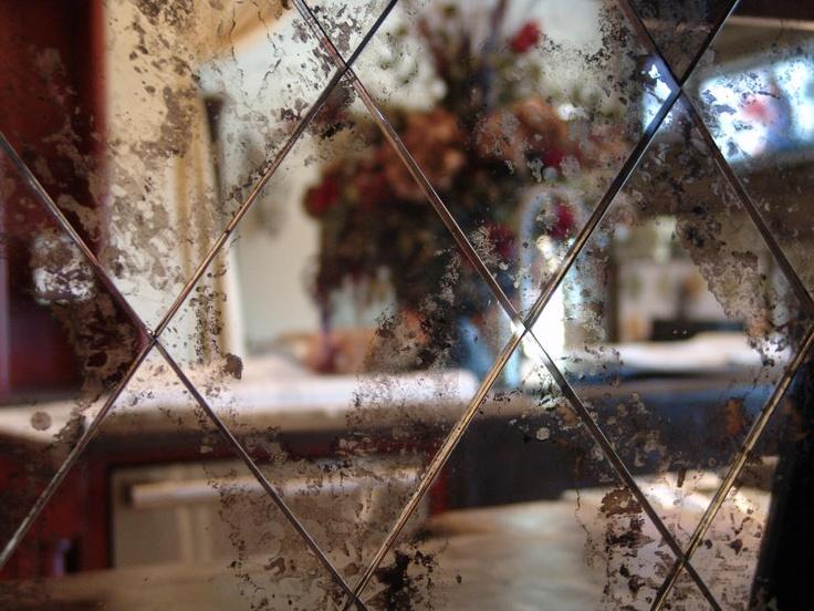 antiqued mirror backsplash