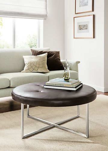 Our Modern, Classic Round Leather Sidney Ottoman Has A Intersecting Steel  Base And Tufted Cushion Top.