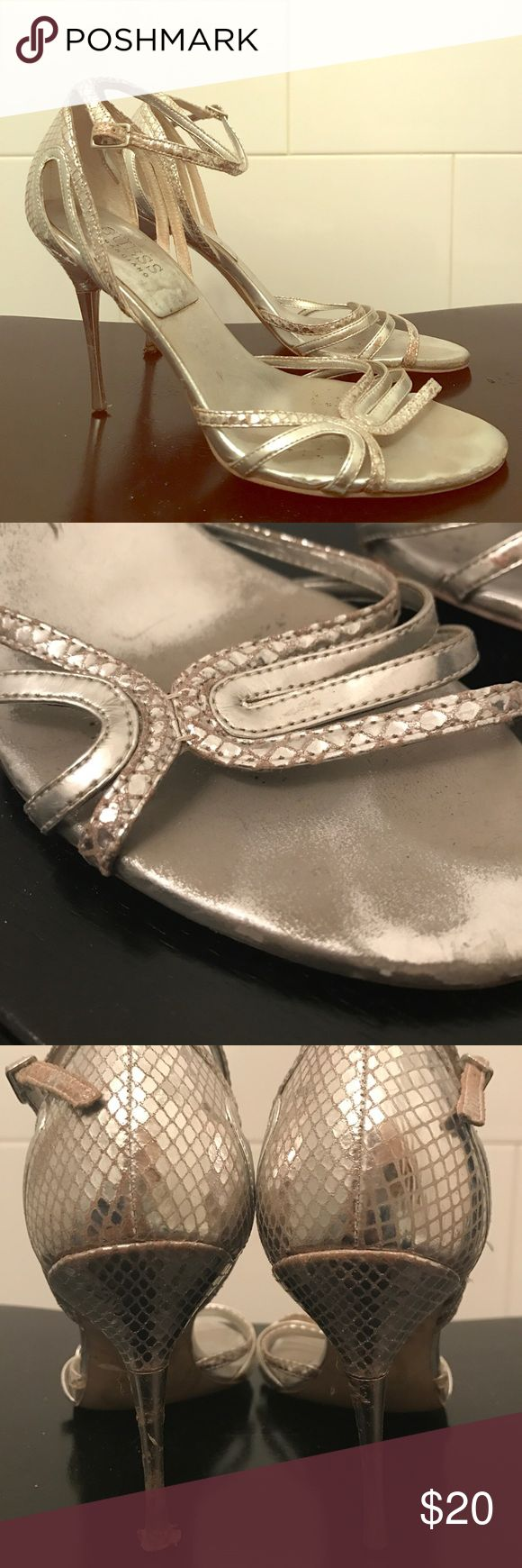 Silver Strappy Sandals Every gal needs a pair. Skinny sturdy heels, delicate straps. Guess Shoes Heels