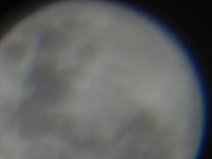 Full Moon Shot from 2013 term 4. it toke me 30 minutes to take this photo because of the moving clouds and range I had with my camera so I grabed some stuff and toke the photo
