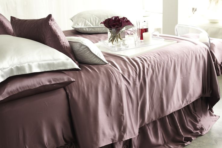 Silk Sheets. Color: Plum.  Our silk sheet sets are gorgeous to look at and an ultra comfortable way to a good night's sleep. Hypoallergenic, kind on your skin and hair, and able to wick away excess moisture, silk has many natural benefits that can contribute to better sleep. | www.manitosilk.com