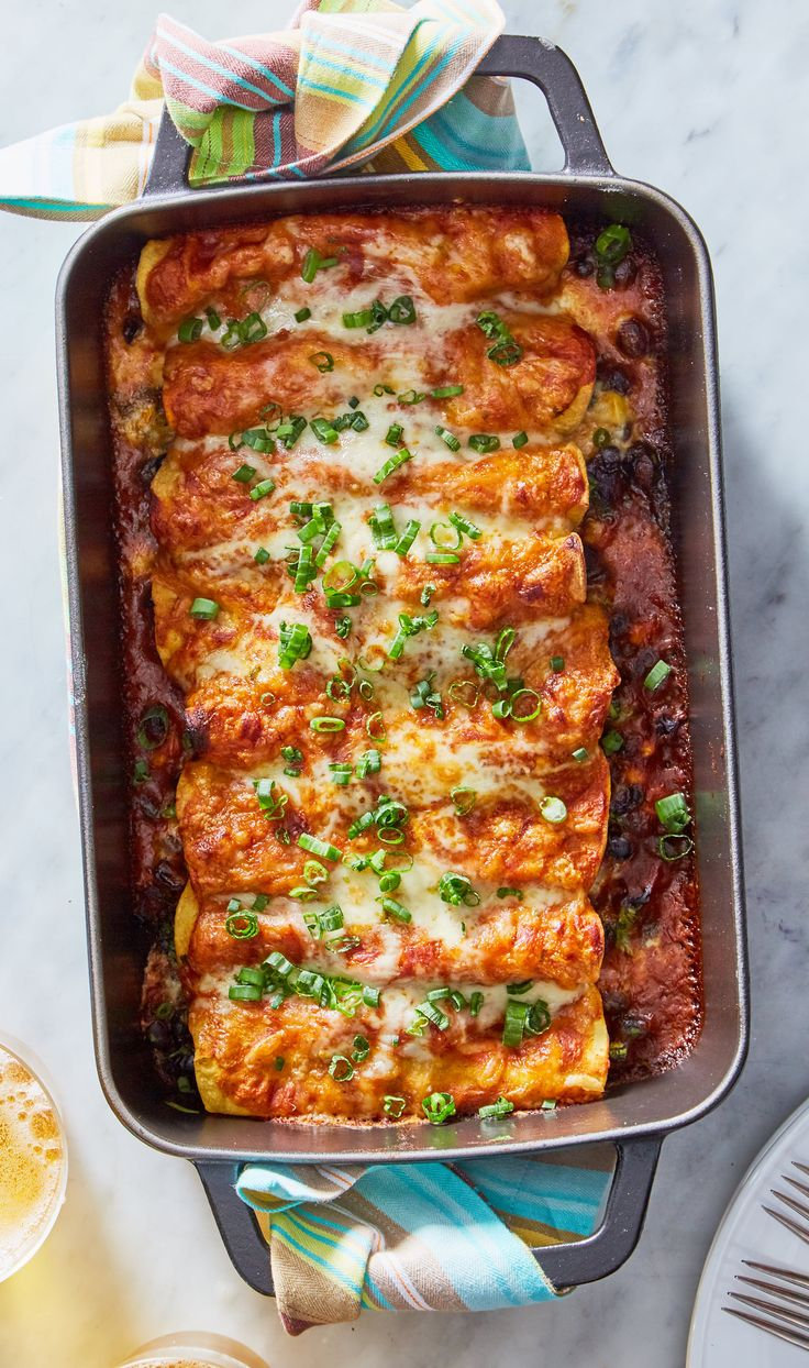 What these vegetable enchiladas lack in meat, they more than make up for in flavor! Filled with colorful vegetables like corn, spinach, and black beans, they're finished off with a rich, velvety chili sauce that's fragrant with spices. Sign up for Martha & Marley Spoon to get seasonal recipes and fresh ingredients delivered to your home each week!