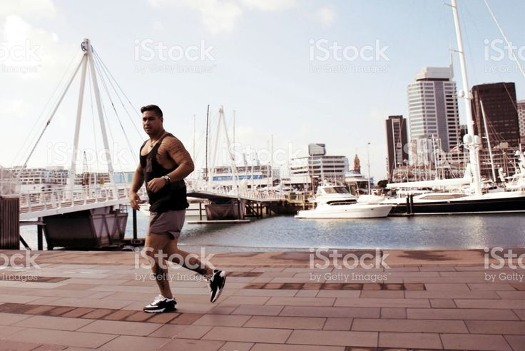 Pacific Island Man Runs against a Cityscape Harbour royalty-free stock photo