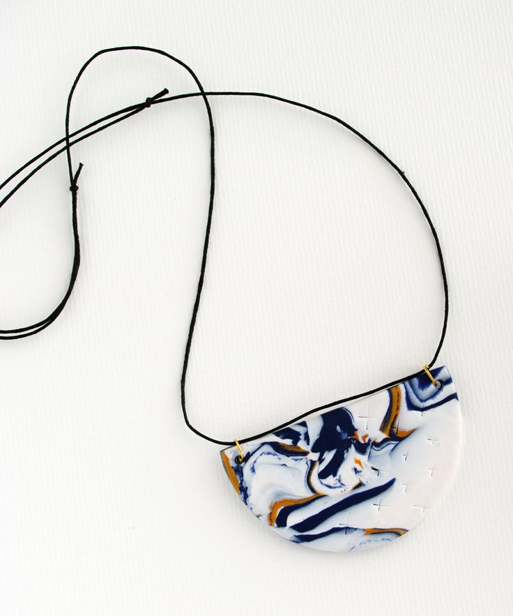 Half Circle Polymer Clay Necklace in a colour palette of navy, white and gold. by colourwork on Etsy