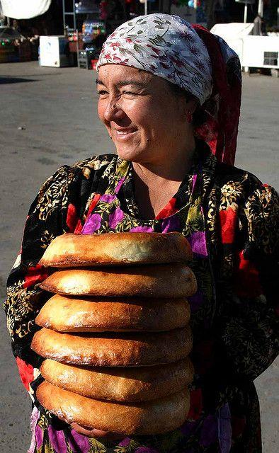 Bread Vendor in Uzbekistan....I miss this bread.