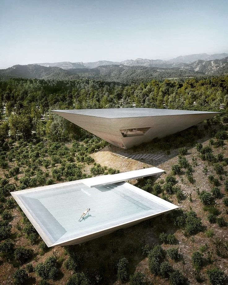 TNA's dream holiday home is an upside-down concrete pyramid