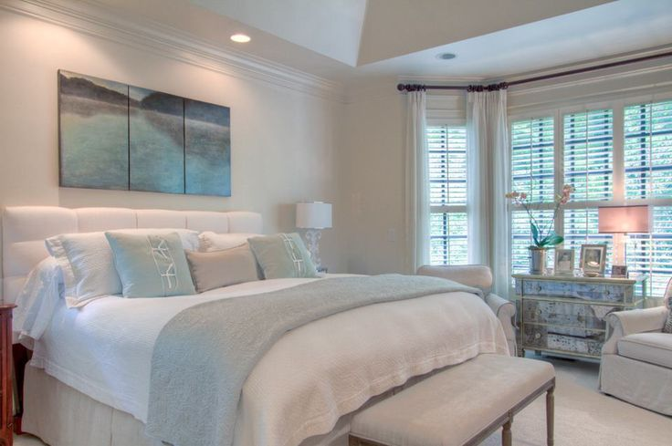 Bedroom ideas. Furniture placement in bay window. Neutral colors with a hint of color.