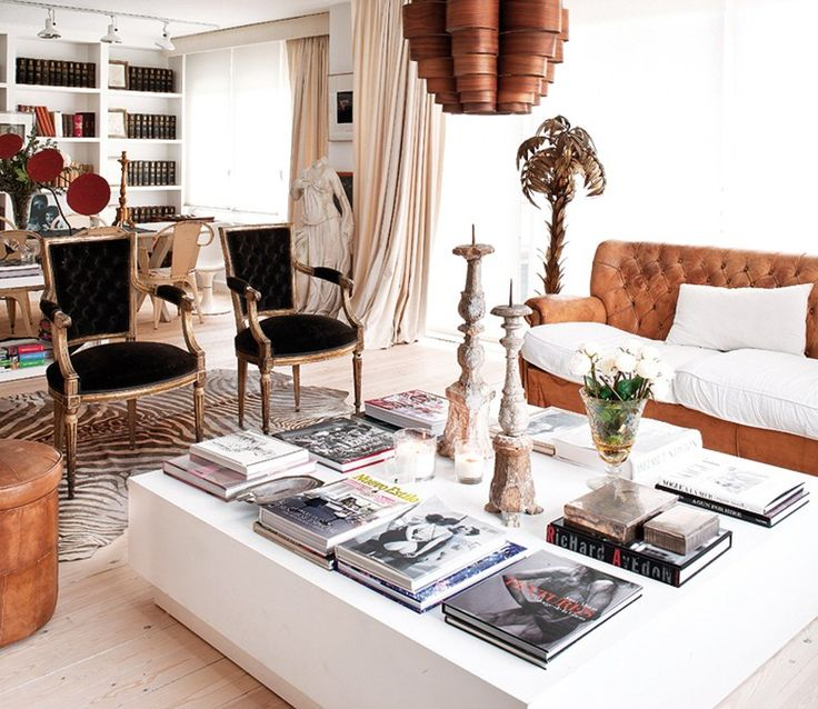 """When people ask """"what's eclectic?""""... French antique chairs; vintage leather sofa; mid century modern wood shade chandelier; Greek sculpture; traditional draperies; and modern white lacquer coffee table"""