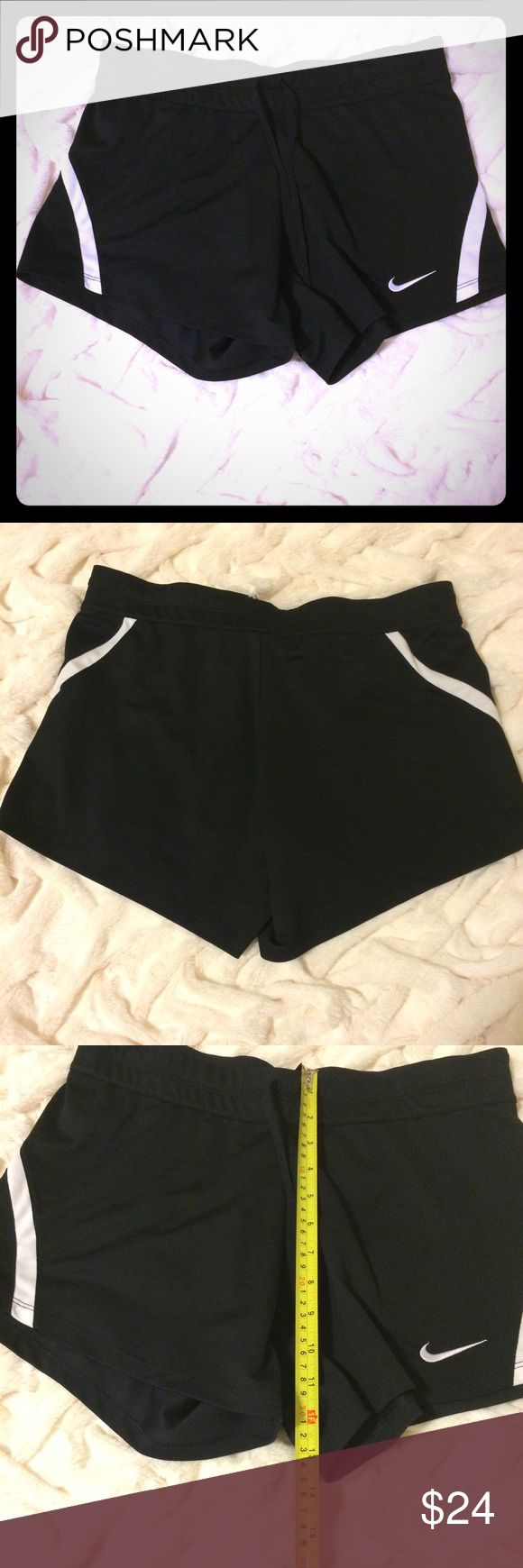 """NWOT Nike Dri Fit shorts NWOT Nike Dri fit shorts. Black with white lines. Elastic waist with draw string. Hidden key pocket in back. 13.5"""" length. 100% polyester. New without tags. Perfect condition Nike Shorts"""