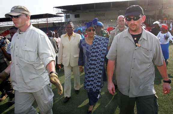 Liberian President Madame Ellen Johnson-Sirleaf escorted by members of the U.S. Diplomatic Security Service