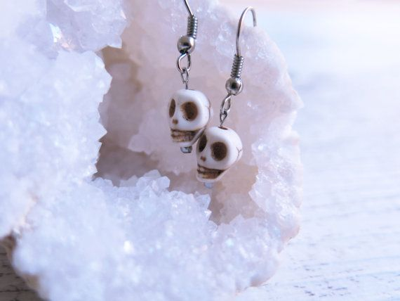 These beautiful earrings feature 1cm howlite stones carved into skulls hanging from a silver plated hook earrings.  Howlite is a stone of