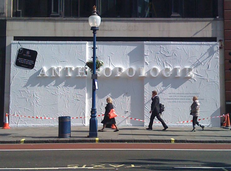 London Store Barricade by Lizania Cruz - Barricade design for Anthropologie's new store in London. The logotype was raised from the surface of the barricade and covered with tyveck material to create a textured 3-d effect.