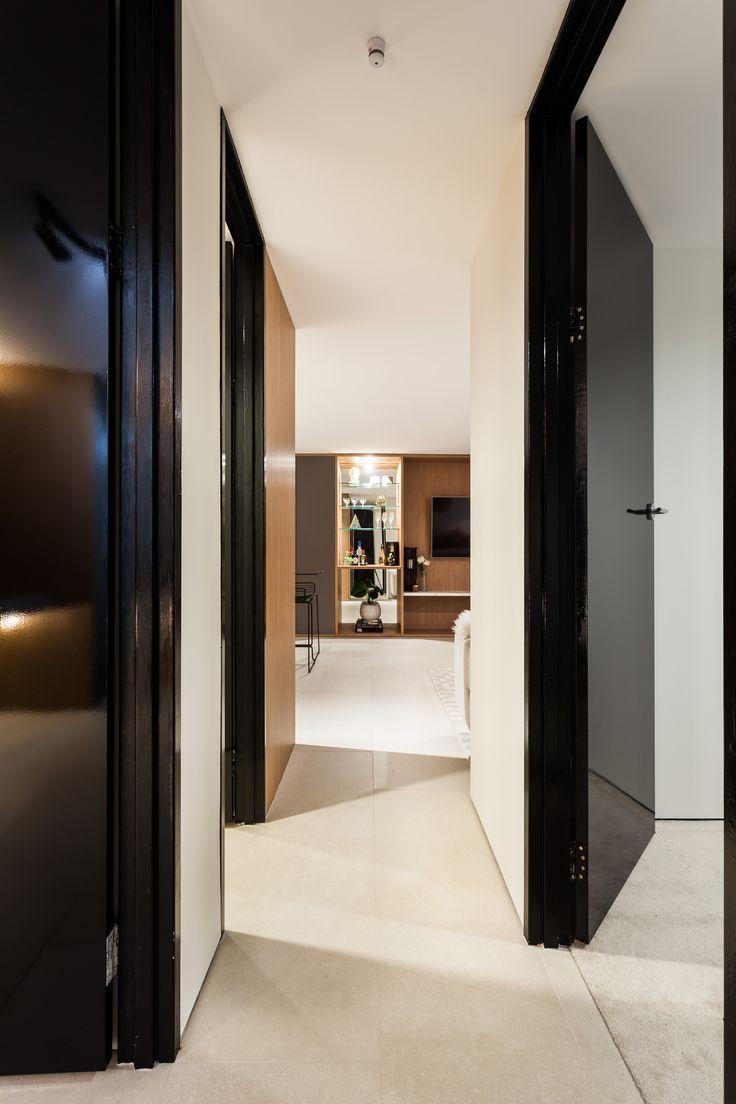 Apartment renovation - Kitchen by LDC. Claremont, Western Australia. #hallway #hall #tall #doors #talldoors #largedoors #blackdoors #timber #negativedetail #floatingwall #floating  #mirroredbar #mirror #bar #modern #modernbar #whitewalls #clean #style #design #designstyle #interiorideas #modernideas #interiordesign