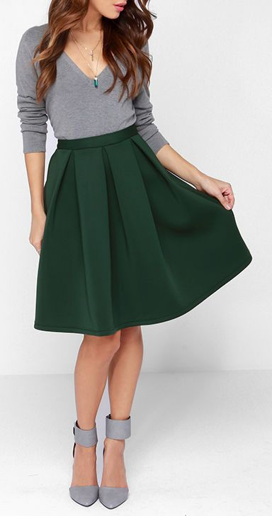 We can't blame you if you fall head over heels for the Perfect Balance Dark Green Pleated Midi Skirt, its cute style is mesmerizing! The fit...