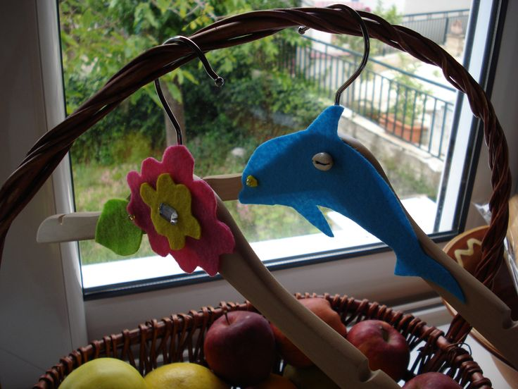Wooden hangers decorated for my daughters.