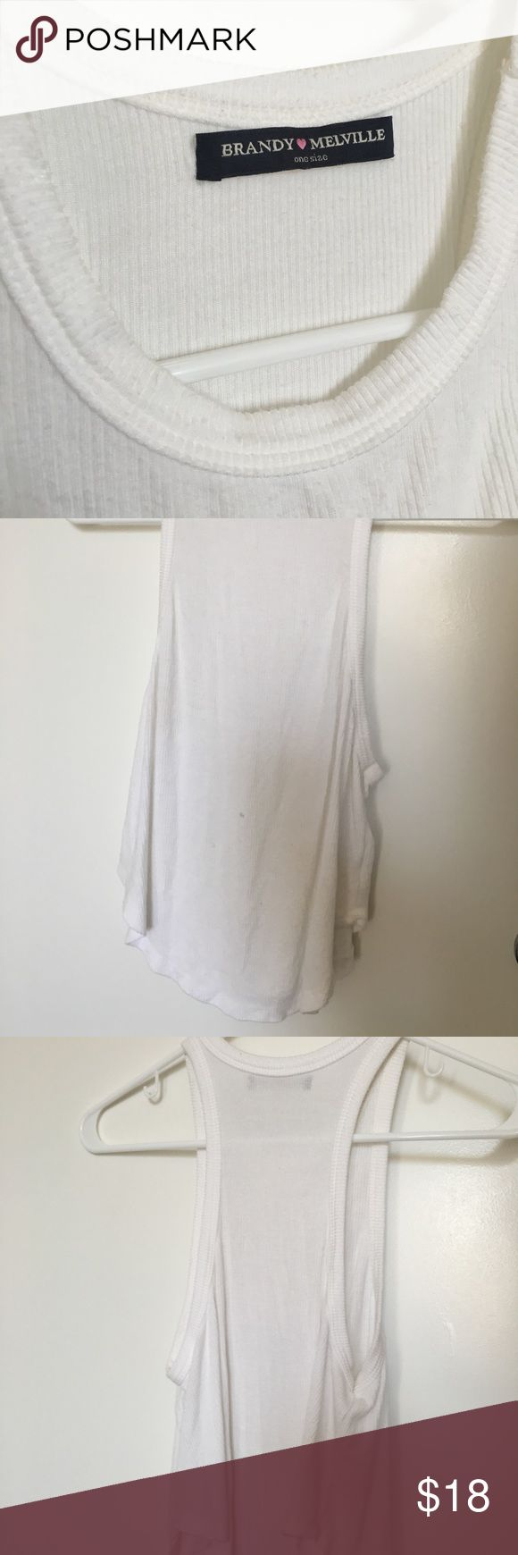 brandy white flowy tank super cute white brandy Melville tank! Only worn a few times, like brand new! Discontinued tank not available online anymore, small mark on the front but removable & will be removed before mailed :) Brandy Melville Tops