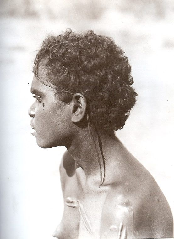 "This photograph was made famous in the brilliant series ""The First Australians"". ""Young Tjingili woman with plaited hair. Powell Creek, Sept-Oct 1901"". From The Aboriginal Photographs of Baldwin Spencer, 1982."