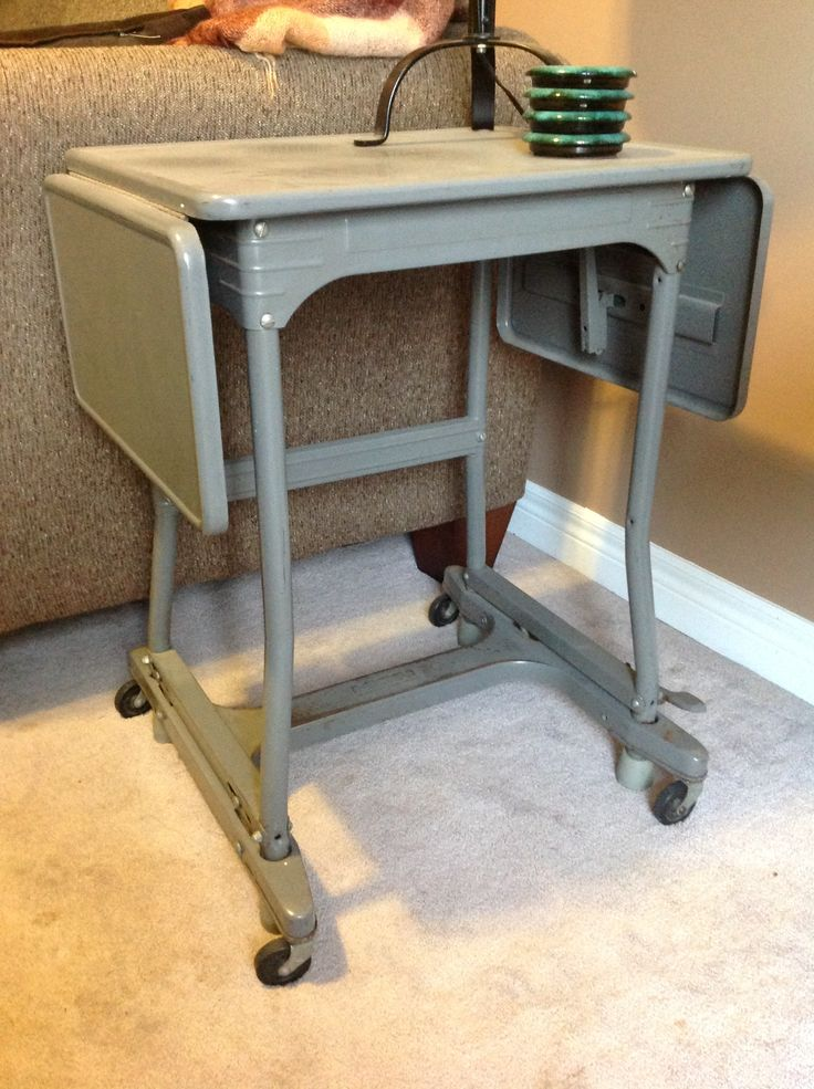 Vintage metal typewriter stand.  Makes for a perfect retro side table!