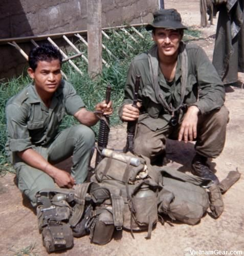 SOG - Spike Team Ohio medic Joe Parnar (right) and team grenadier Mock, a Rhade Montagnard, after returning from a mission. Photo taken: Summer 1968, Kontum (CCC)