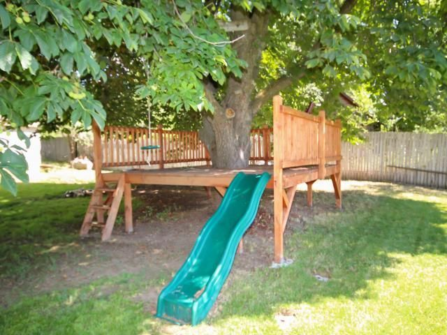 Kid's Tree Deck.  Cool take on a tree   house.  Could also attach to the play set with a rope bridge?