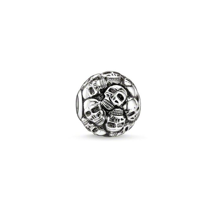 THOMAS SABO Karma Bead from the Sterling Silver Collection. skulls - 925 Sterling silver, blackened Size: ca. 1.1 cm The masculine Skulls bead crafted from 925 Sterling silver lends the looks a rebellious attitude. The exquisite 925 Sterling silver bead is so beautifully detailed that the bead really dazzles when combined with black obsidian and gives any rebel style a real impact.