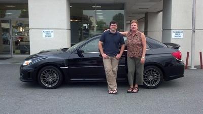 Folger Subaru Internet Sales Consultant Elizabeth Ziegler with Mr. Kavulic and his 2012 Subaru WRX sports car!