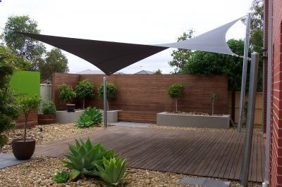 sun shade sail for our patio = inexpensive, easy and removable. I cant wait to install ours :)... or I cant wait for summer!
