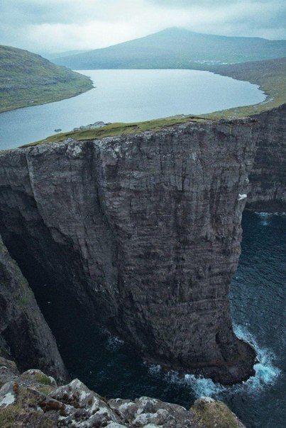 balenciaga clothing lake hanging over sea  island Vagar  Faroe islands  Denmark   One day      Denmark  Lakes and Islands