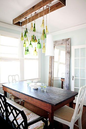 love the use of the rustic floor mirror (& lets not discount the beautiful wine bottle light fixture!)