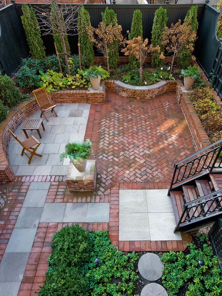 A walled, brick-floored terrace brings an extra level of living space to this Brooklyn, N.Y., townhouse. High walls that surround the space offer privacy, and plantings at various heights pop against the wall's dark green paint. Contemporary wood folding chairs provide simple seating, while the spacious patio leaves plenty of room for entertaining.