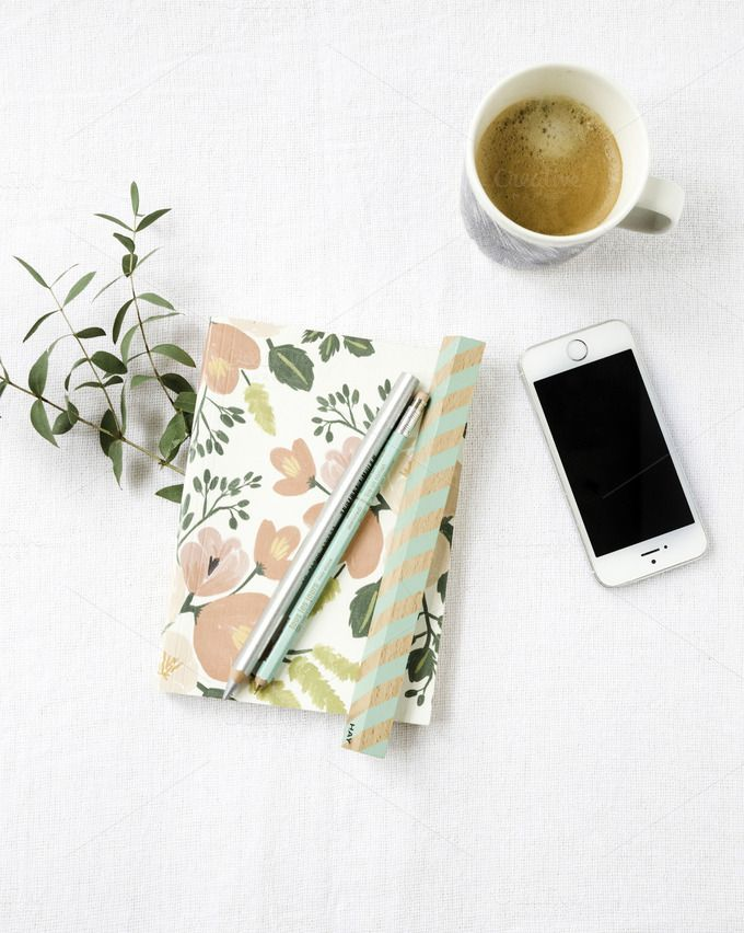 Styled Stock Photo Coffee mint by Petra Veikkola. This listing is for a single high resolution digital styled stock image of beautifully styled feminine desktop featuring eucalyptus branches, a silver and mint pen, ruler, iPhone, coffee in Marimekko mug and floral peach notebook. The image is feminine and simple and gives your brand a beautiful boost.