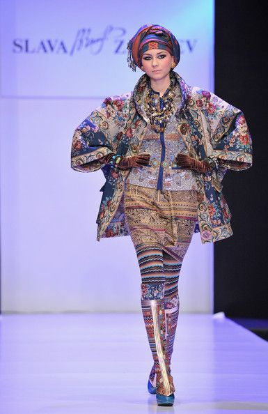 A model wears a creation by designer Slava Zaitsev on Day 1 of the Mercedes-Benz Fashion Week Russia Fall/Winter 2011/2012 at the Congress H...