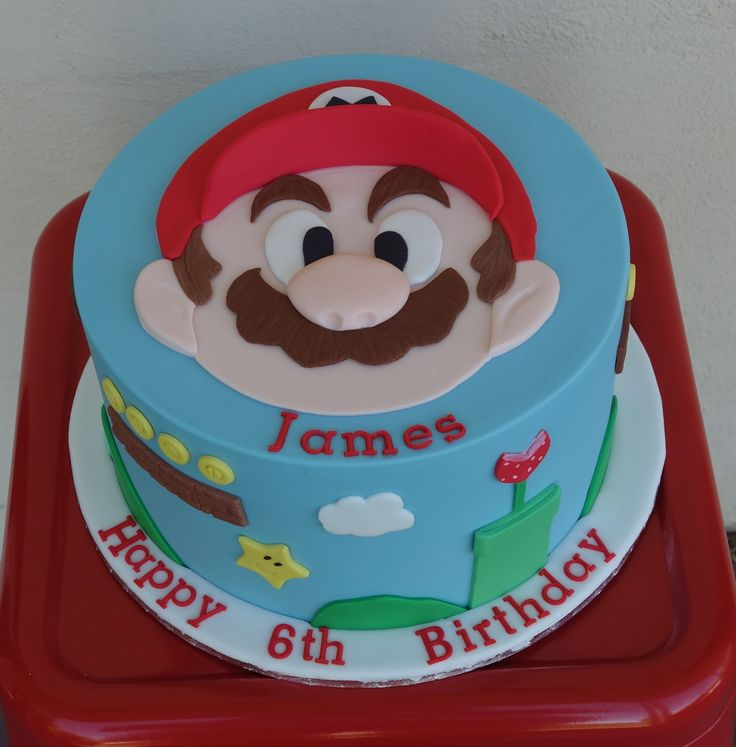 Mario Brothers birthday cake with 2D hand cut Mario on top.  Visit my Facebook page Driving Me Cakey or contact me via e-mail drivingmecakey@gmail.com. Located in South Australia.