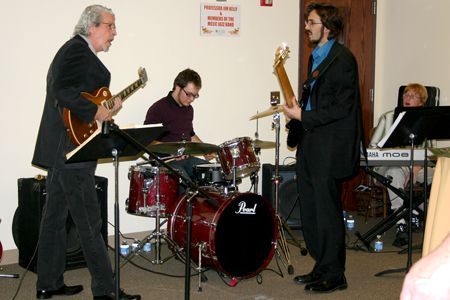 In spring of 2011, Professor James Kelly, far left, performs with Jazz Band members, from left, percussionist Troy Veglatte, bassist Benjamin Russert and and pianist Kurt Moreton.