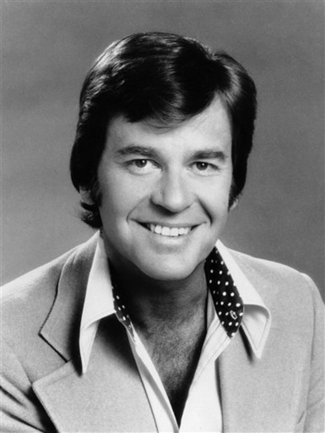 "In this 1974 file photo originally provided by ABC-TV, ""American Bandstand"" host Dick Clark is shown. Clark, the television host who helped bring rock `n' roll into the mainstream on ""American Bandstand,"" died Wednesday, April 18, 2012 of a heart attack. He was 82. (AP Photo/ABC)"
