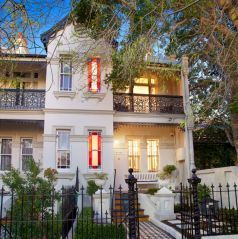 Victorian residence, Victorian Italianate villa, period charm, wrought iron fence, stained glass windows