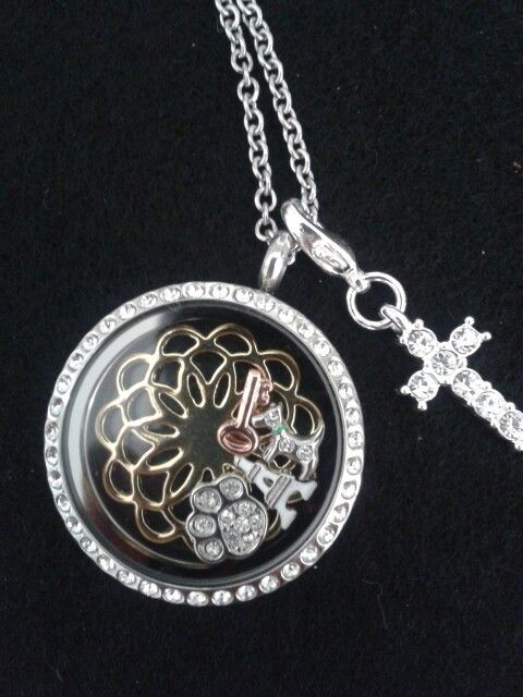 South hill designs clear crystal locket, gold screen etc designed by Ozan.