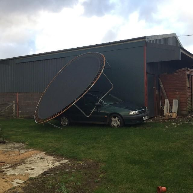 The trampoline decided to stretch its legs #wind #storm