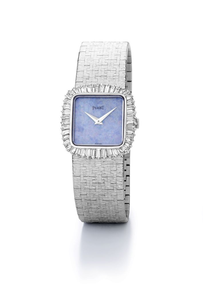 Jewellery watch in white gold set with 44 baguette-cut #diamonds and opal dial. Vintage from 1965.
