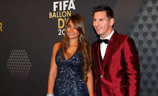 Lionel Messi and Wife at World Footballer of The Year Awards2.  Keep Reading: http://zegist.com/fifa-ballon-dor-messis-red-suit/